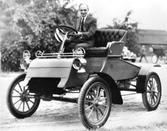 Henry Ford in his car